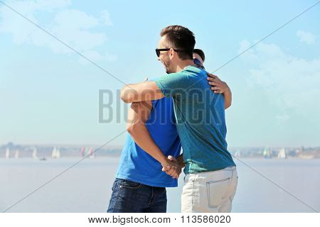 Two young men meeting on the riverside
