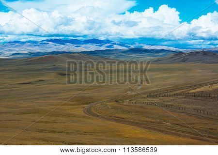 Road Stretches Into The Distance Across The Steppe