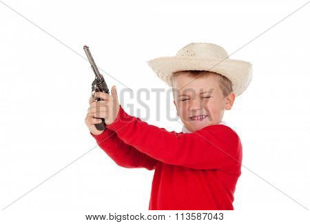 Small boy playing with a gun isolated on white background