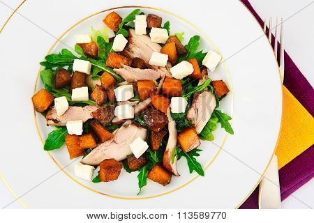 Salad with Chicken, Arugula, Caramelized Pumpkin and Feta Cheese