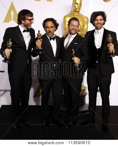 Alejandro G. Inarritu, Alexander Dinelaris, Nicolas Giacobone and Armando Bo at the 87th Annual Academy Awards - Press Room held at the Loews Hollywood Hotel in Los Angeles, USA February 22, 2015.