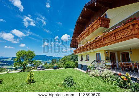 typical alpine guest house in summer season, near mondsee lake, Austria