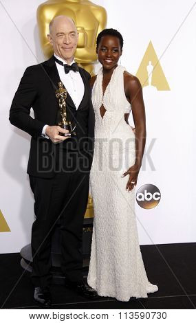 J.K. Simmons and Lupita Nyong'o at the 87th Annual Academy Awards - Press Room held at the Loews Hollywood Hotel in Los Angeles, USA on February 22, 2015.
