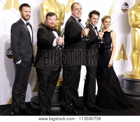 Thomas Curley, Ben Wilkins, Craig Mann, Chris Evans and Sienna Miller at the 87th Annual Academy Awards - Press Room held at the Loews Hollywood Hotel in Los Angeles, USA on February 22, 2015.