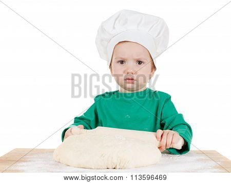 Serious Little Boy Kneading Dough For The Cookies, Isolated On White