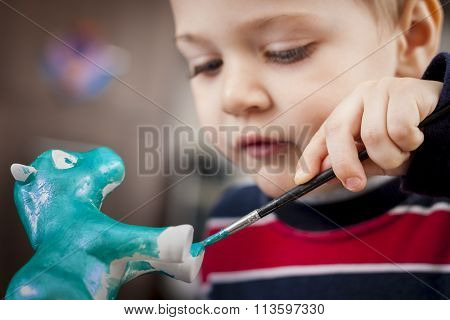 Boy Painting Ceramic Figure