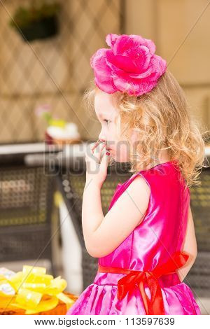 Little Adorable Girl Celebrating 3 Years Birthday.  Kid  Wearing Flower Hairband On Party Outdoors O