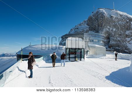 People enjoy the mountain view from the terrace on top of the Pilatus mountain, Lucerne, Switzerland