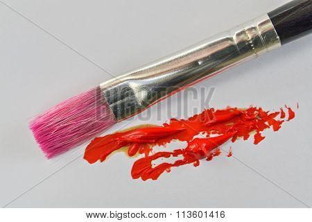 Paintbrush And Red Oil Color