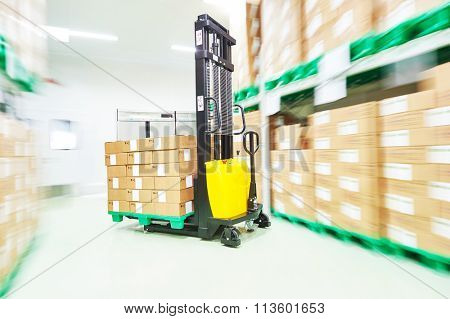 warehouse stacker loader truck at work