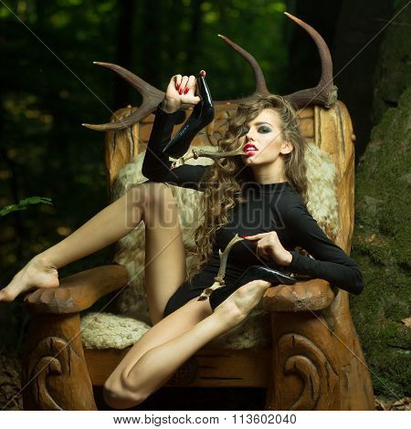 Pretty Woman With Antlers On Shoes