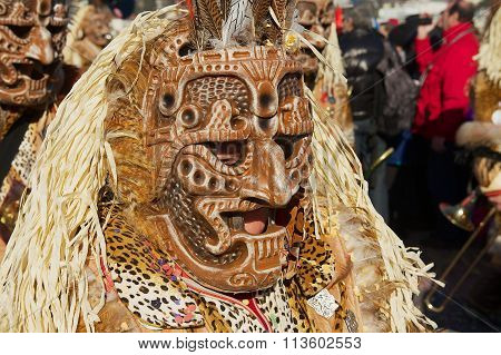 Person wears a carnival costume and mask at Lucern Carnival in Lucerne, Switzerland.