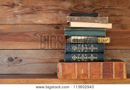 books on a wooden shelf