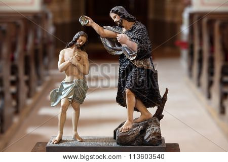 STITAR, CROATIA - AUGUST 27: Baptism of the Lord statue on the baptismal font in the church of Saint Matthew in Stitar, Croatia on August 27, 2015