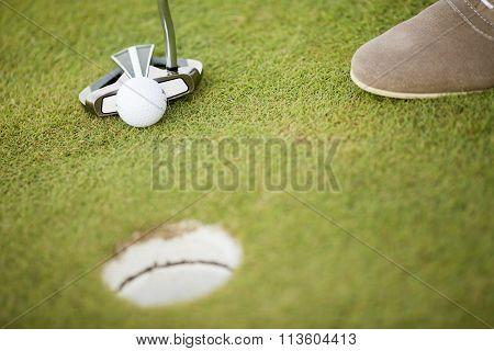 Golf Ball, Putter And Boy's Legs On Green