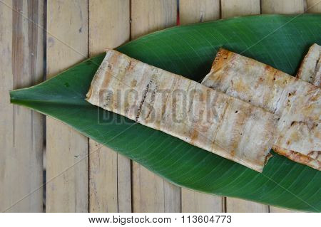 grilled flat banana Cambodian food on banana leaf