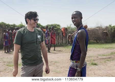MASAI MARA, KENYA - FEB 2015 - Tourist visits village. Tribe, dressed in national costume, ceremony