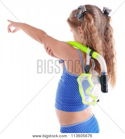 Happy little girl in blue swimsuit with diving mask poses on white background