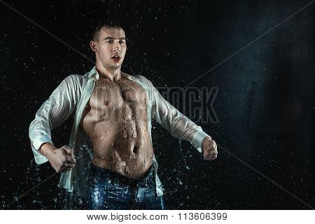 Man White Shirt Standing Under The Water Droplets.