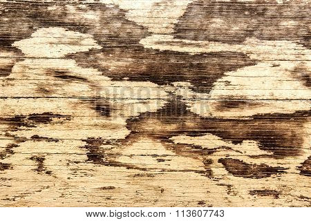 Weathered wood painted pale yellow.