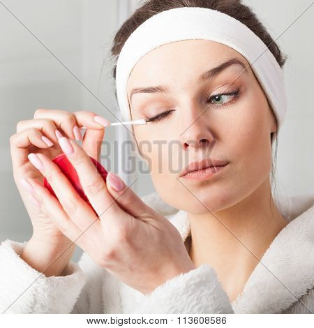 Woman Removing Eyes Make-up