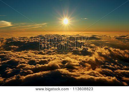Mount Fuji Sunrise above clouds in japan.