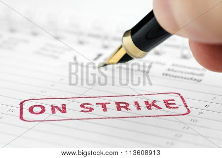 Close Up Of On Strike Stamp