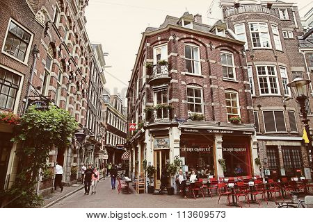 Amsterdam, The Netherlands - August 16, 2015: People Walk On The Street Gravenstraat, Street Life, B