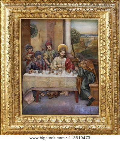 STITAR, CROATIA - AUGUST 27: Matthew invited Jesus home for a feast, altarpiece on altar of St. Anthony the Great in the church of Saint Matthew in Stitar, Croatia on August 27, 2015