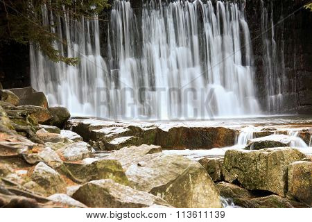 Wild Waterfall In The Polish Mountains. River With Cascades