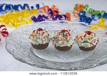 Three Miniature cupcake cake balls on glass plate