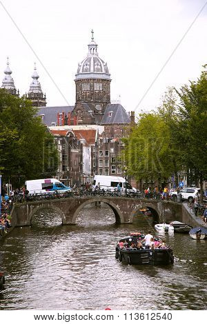 Amsterdam, The Netherlands - August 19, 2015: View On Saint Nicholas Church Or St Nicolaas Kerk Towe