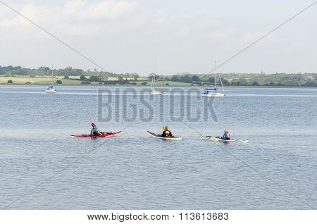 Three canoeist going along the river