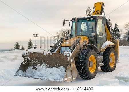 Yellow Stationary Jcb Digger In Snow
