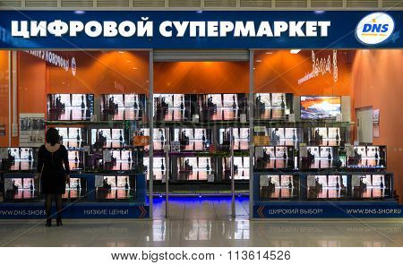 Television Store And A Woman