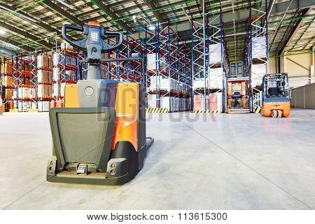 Pallet forklift truck at warehouse