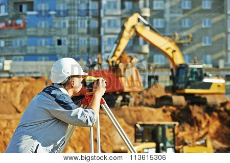 Surveyor working with theodolite equipment