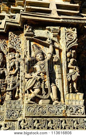 Artistic sculpture of Hindu deities at Hoysaleswara temple at Halebidu, Karnataka