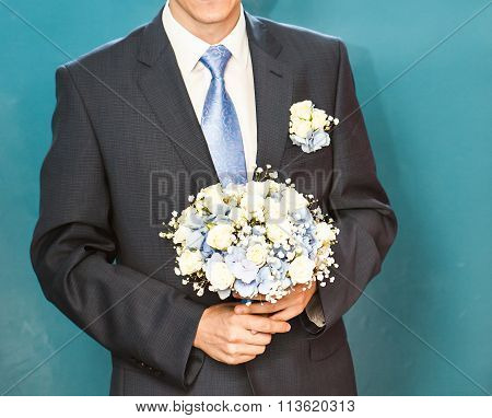 Groom waiting bride. Just married. Close up. Bridal wedding bouquet of flowers