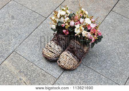 Bouquet of flowers in wattled boots