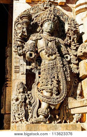 Artistic sculpture of Hindu deities at the entrance of Hoysaleswara temple at Halebidu, Karnataka