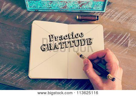 Motivational Message Practice Gratitude Written On Notebook