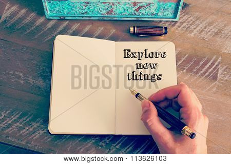 Motivational Message Explore New Things Written On Notebook