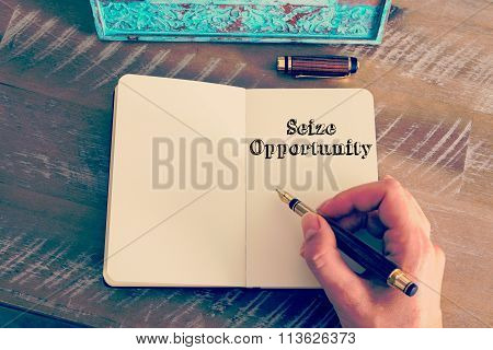 Motivational Message Seize Opportunity Written On Notebook
