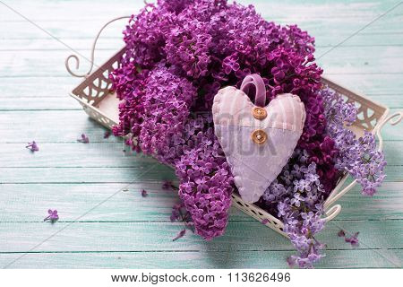 Background  With Fresh Splendid Lilac Flowers On Tray  And Decorative Heart