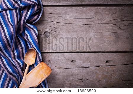 Kitchen Towel And Kitchen Tools On Vintage  Wooden Background.