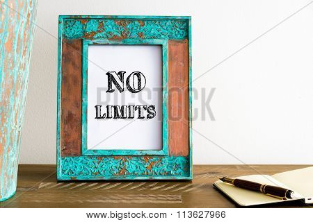 Vintage Photo Frame On Wooden Table With Text No Limits