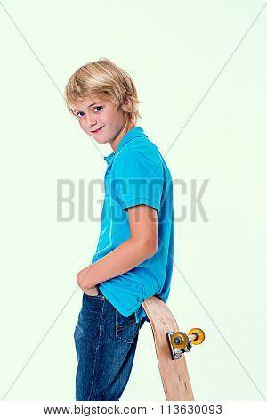 Boy In Blue Dress With Skateboard