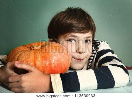 Boy With Big Orange Pumpkin Close Up Portrait