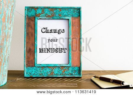 Vintage Photo Frame On Wooden Table With Text Change Your Mindset